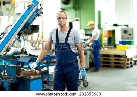 worker on the machine - stock photo