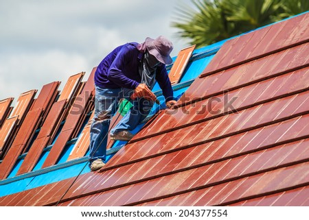 Worker on the roof  - stock photo