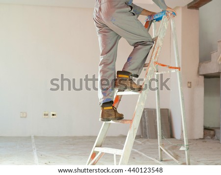 Worker painting ceiling  - stock photo