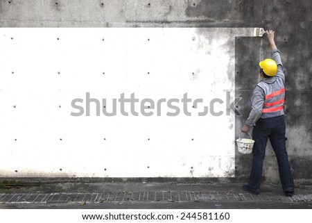 worker painting the old wall in white - stock photo