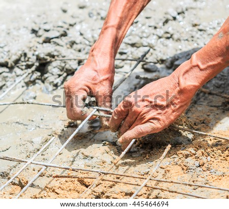 Worker pouring cement in construction site