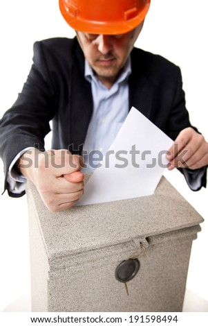 worker putting letter in mailbox,showing a fig sign on white background - stock photo