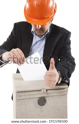 worker putting letter in mailbox,showing thumbs up gesture on white background - stock photo
