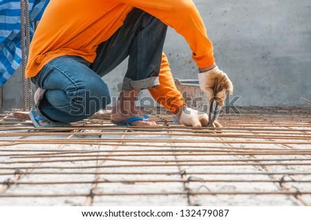 worker rebar gridwork across a floor for strength rebar worker