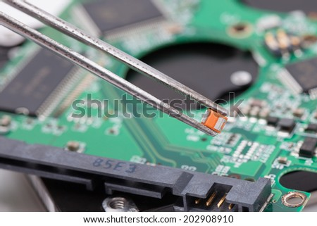 worker repair green harddisk pcb.