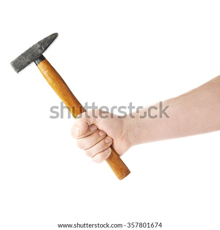 Worker's caucasian male hand holding a hammer tool, composition isolated over the white background - stock photo