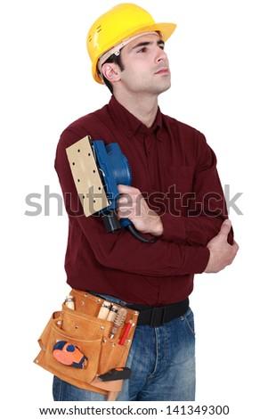 Worker sanding - stock photo