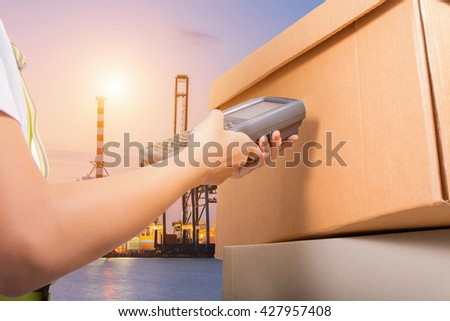 Worker Scanning Package In Warehouse.  - stock photo