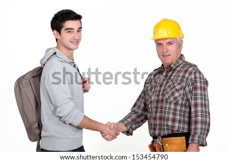 Worker shaking hands with student - stock photo
