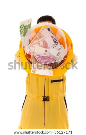 worker showing his helmet full of money - stock photo