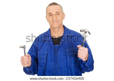 Worker showing his wrench and hammer.