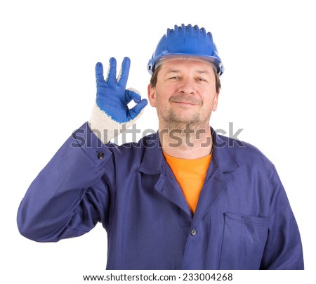 Worker shows hand sign okey. Isolated on a white background. - stock photo