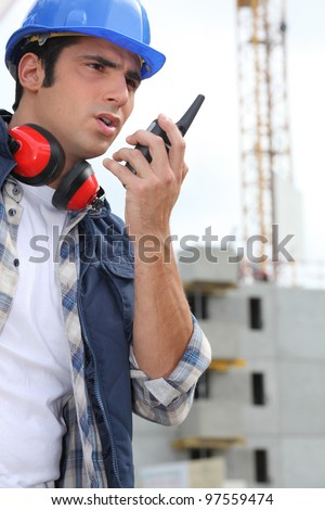 Worker talking over the talkie - stock photo