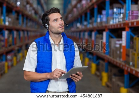 Worker touching a digital tablet in warehouse
