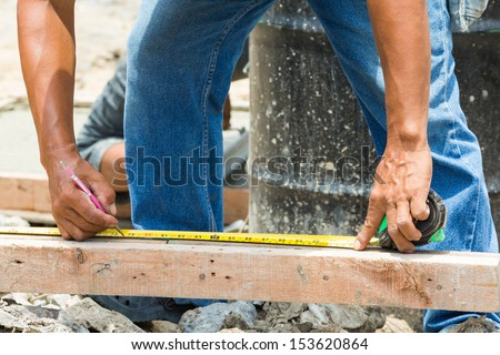 Worker use cartridge meter measuring in construction site - stock photo