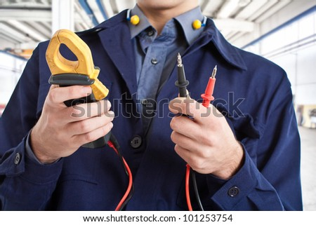 Worker using a tester - stock photo