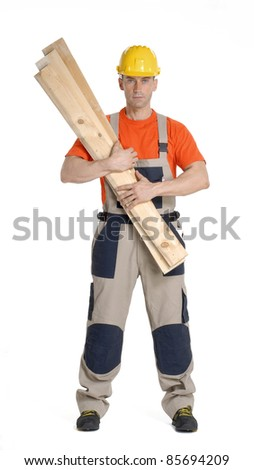 Worker using gloves and holding wood boards.