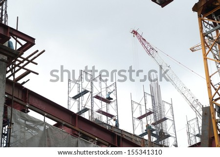 Worker was working on scaffolding at construction site - stock photo