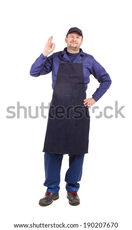Worker wearing black apron. Isolated on a white background.