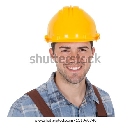 Worker wearing hard hat. Isolated on white