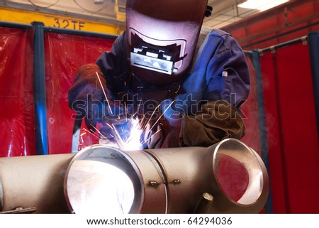 worker weld metal in factory and sparks - stock photo
