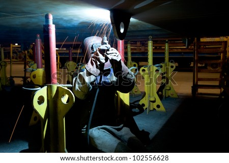 worker weld metal in factory and sparks spread - stock photo