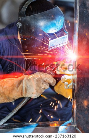 worker welding construction by welding - stock photo