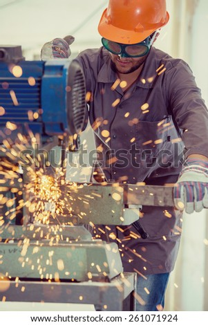 Worker welding in industrial background at factory - stock photo