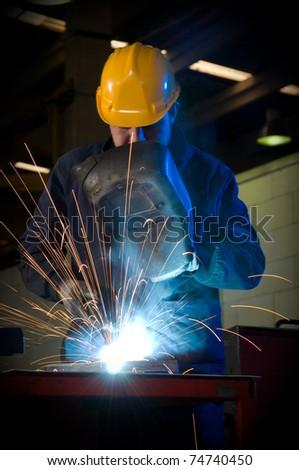 Worker welding steel - a series of METAL INDUSTRY images. - stock photo