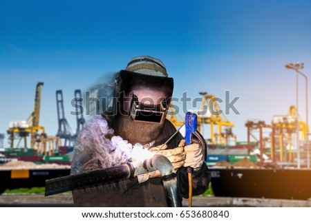 worker welding steel piping Double exposure for a downtown city and industrial blur sky background for industrial and construction concept