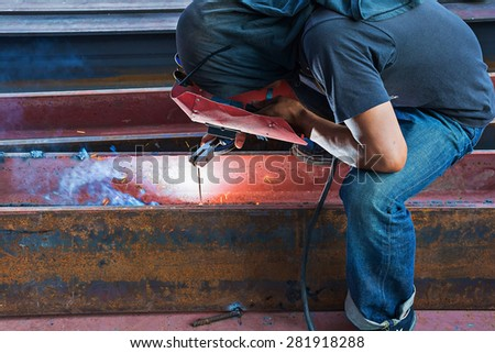 worker Welding steel with electricity. - stock photo