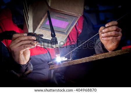 Worker welding the aluminum - stock photo