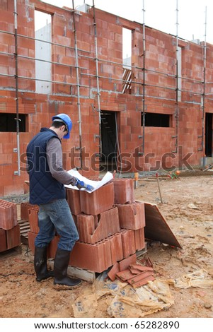 Worker with a red brick