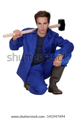 Worker with a sledgehammer - stock photo