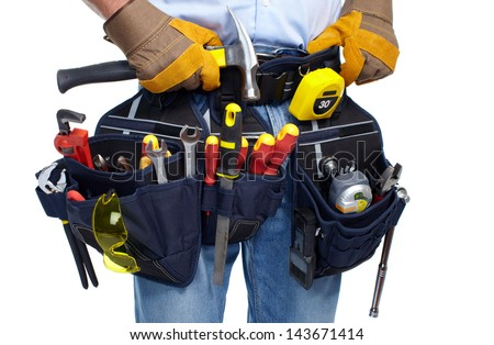 Worker with a tool belt. Isolated over white background. - stock photo