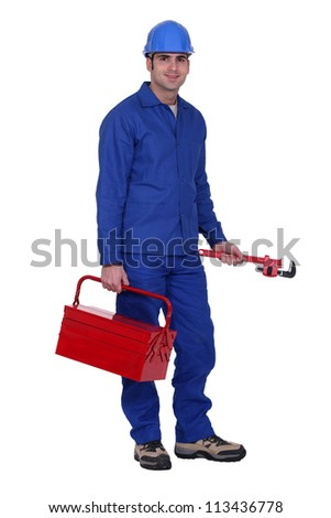 Worker with a wrench and toolbox - stock photo