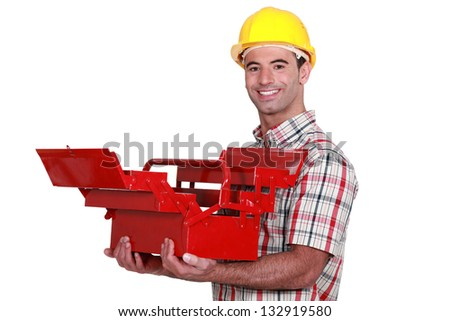 Worker with an open toolbox - stock photo