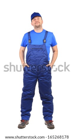 Worker with arms in pockets. Isolated on a white background.