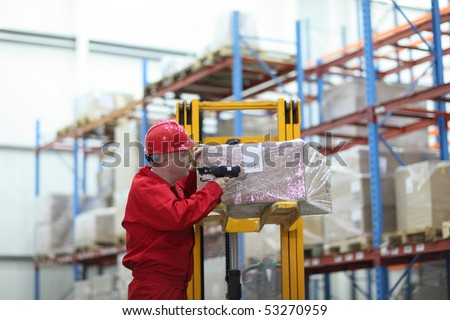 worker with bar code reader - close up - stock photo
