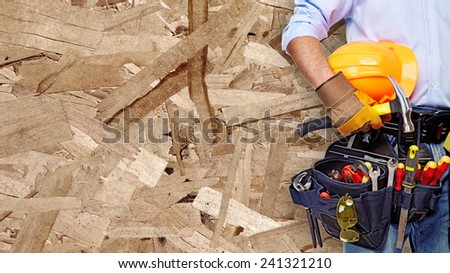 Worker with construction tools. House renovation background. - stock photo