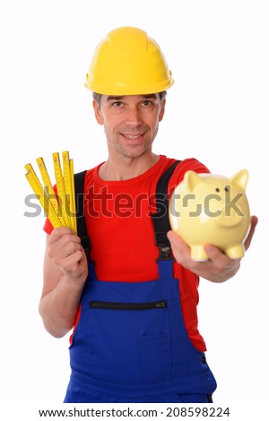 worker with folding yardstick and piggy bank - stock photo