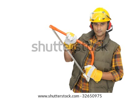 Worker with hat and protection phones isolated in white
