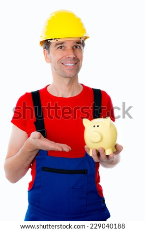 worker with helmet is pointing of a piggy bank - stock photo