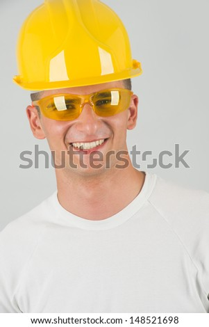 Worker with protective glass and hard top smiling - stock photo