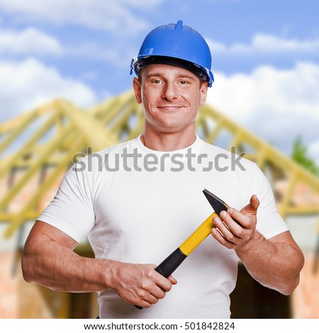 Worker with tools. Construction and house renovation concept.