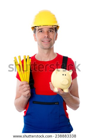 worker with yardstick and piggy bank - stock photo