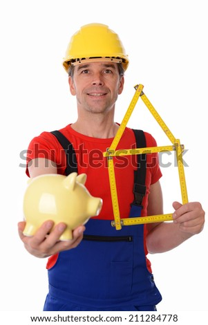 worker with yardstick- house and piggy bank - stock photo