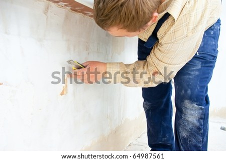 worker with yellow knife - stock photo