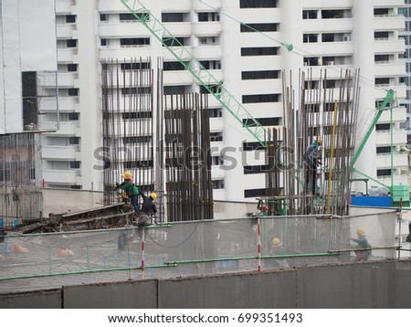 worker work together to make wire structure of stake