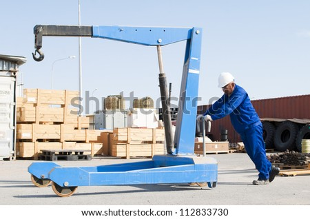 worker works at a warehouse - stock photo